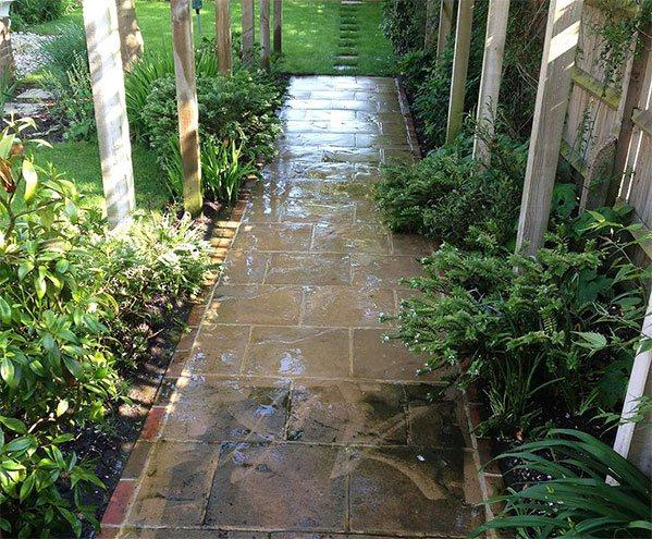 Tiled patio cleaned with pressure washing equipment.