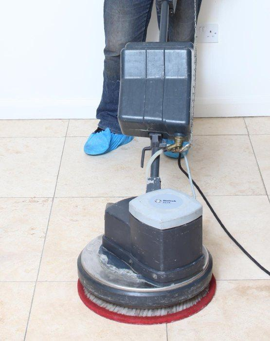 Fantastic cleaner cleaning tile and grout with a machine