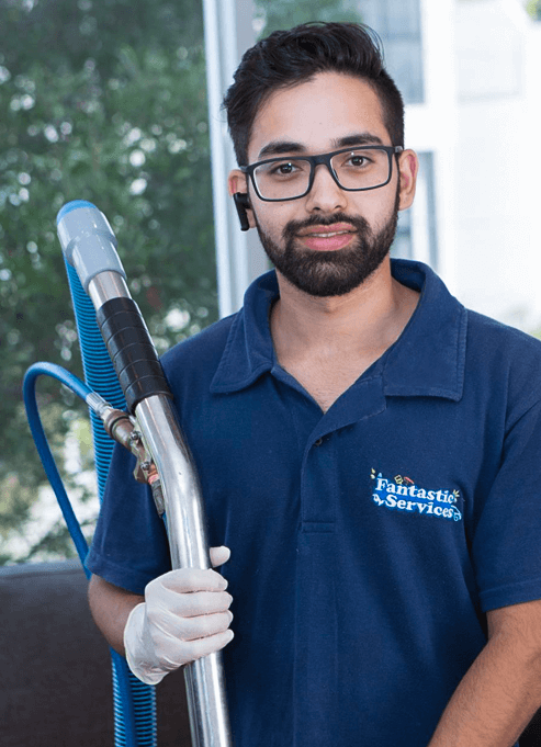 Steam carpet cleaning technician