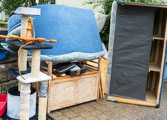 A pile of old furniture prepared for disposal
